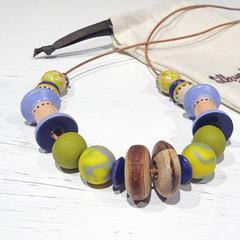 Necklace. Just Rolling Along - N327W. Hand-painted and hand-carved wood, polymer