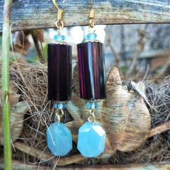 Elongated rectangular purple and turquoise earrings.