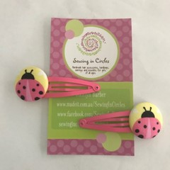 Pink ladybug hair clips