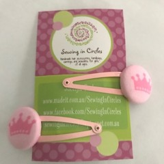 Pink crown hair clips