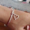 Sterling silver bangle with heart charm   Hammered silver bracelet with heart