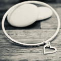 Sterling silver bangle with heart charm | Hammered silver bracelet with heart