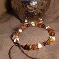Brown macrame bracelet w Garnet, Tiger's Eye, Carnelian and Howlite chips