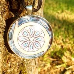 Spinning Flower Pendant