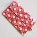 Red and cream geometric clutch bag