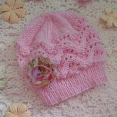 Hand-knitted baby girl's lacy beanie w flower; fits NB; 4-ply Australian wool