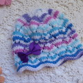 Hand-knitted baby girl's lacy beanie w bow hairclip, fits 0 - 4 months, acrylic