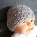 Baby girl's beanie w eyelet pattern & bow, fits 0 - 4 months, acrylic