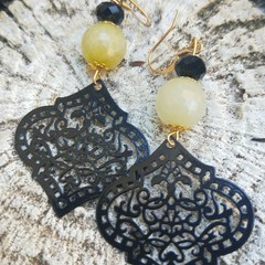 Yellow & black glass bead earrings with laser cut moroccan style hangers.