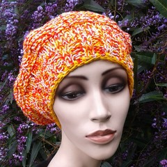 Cotton beret knitted in orange tweed