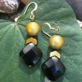 Black & gold glass retro earrings.