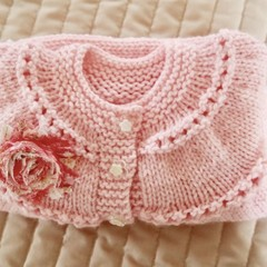 Size 0-6 months: knitted, cardigan/jacket & rosette: peachy pink, washable, girl
