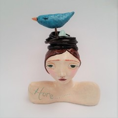 Home girl clay bust nest and bird. Whimsical