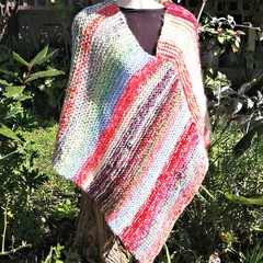 Poncho with candy stripes