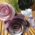 Small and large hand crafted paper flowers in a recycled vase