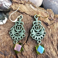 Coloured metal filigree hangers with iridescent green glass drops.