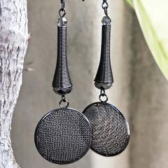Dark silver metal 'Mad Max' earrings.