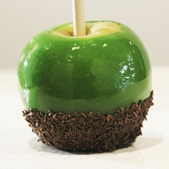 Classic red or green toffee apples with sprinkles