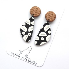 Moon black and white and bronze drop leaf graphic earrings