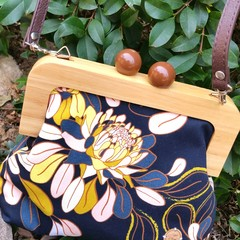 Yellow floral on black Handbag