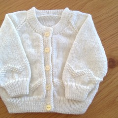 CREAM MOSS STITCHED BORDERED CARDIGAN KNITTED TO FIT 3 TO 6 MONTHS.