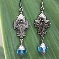 Fleur de lis metal earrings with blue Czech glass bead.