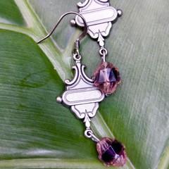 Art deco style metal hanger with purple Czech bead.