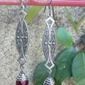 Florentine art deco style elongated hanger with Czech facetted red bead.