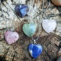Semi-precious gemstone hearts on simple silver plated chain.