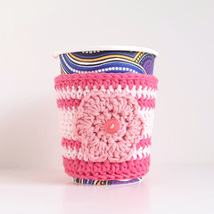 Coffee cup cosy; pink tones; flower motif; cup cover; crochet