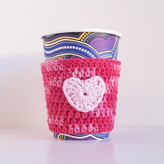 Coffee cup cosy; pink tones; heart motif; cup cover; crochet