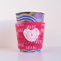 Coffee cup cosy; pink tones; heart motif; cup cover; crochet