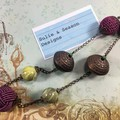 Elegant, antique style beaded necklace on bronze chain. Purple and green