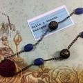 Elegant, antique style beaded necklace on bronze chain. Blue and purple