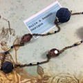 Elegant, antique style beaded necklace on bronze chain. Blue, gold and purple