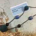 Elegant, antique style beaded necklace on bronze chain. Blue and teal