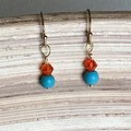 Dainty Orange crystal bead with turquoise gemstone.