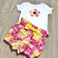 Baby floral bloomers in a two piece set of nappy cover and bodysuit.