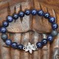 Blue Goldstone and Lava Bead Flower Bracelet