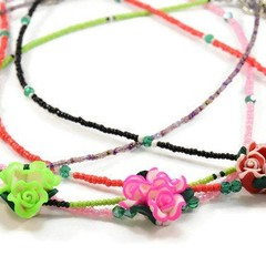 Colourful Seed Bead Necklaces with a Clay Rose Centre. These are available in Bl