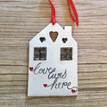 Love Lives Here - decorative wall hanging tile