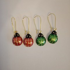 Gold green and red ladybird earrings