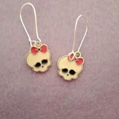 White skull with bow earrings