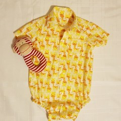 Yellow giraffes - button down shirt/romper with snap close crutch. Size 00