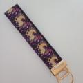 Purple and gold horse print key fob wristlet