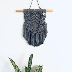 Dark grey macrame wall hanging