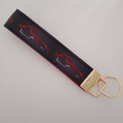 Black and red sports car key fob wristlet