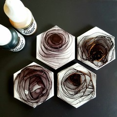 Hexagon tile magnets; alcohol ink + resin, charcoal with gold highlights.