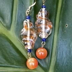 Large ornamental orange & blue wavy bead earrings.