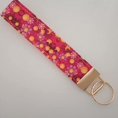 Bright pink and yellow flower key fob wristlet